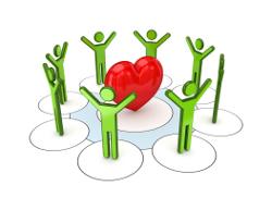 Grüne Menschen um rotes Herz
